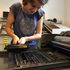 Students printing on a press