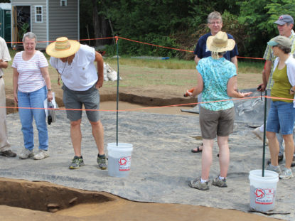 adults at archaeological dig site