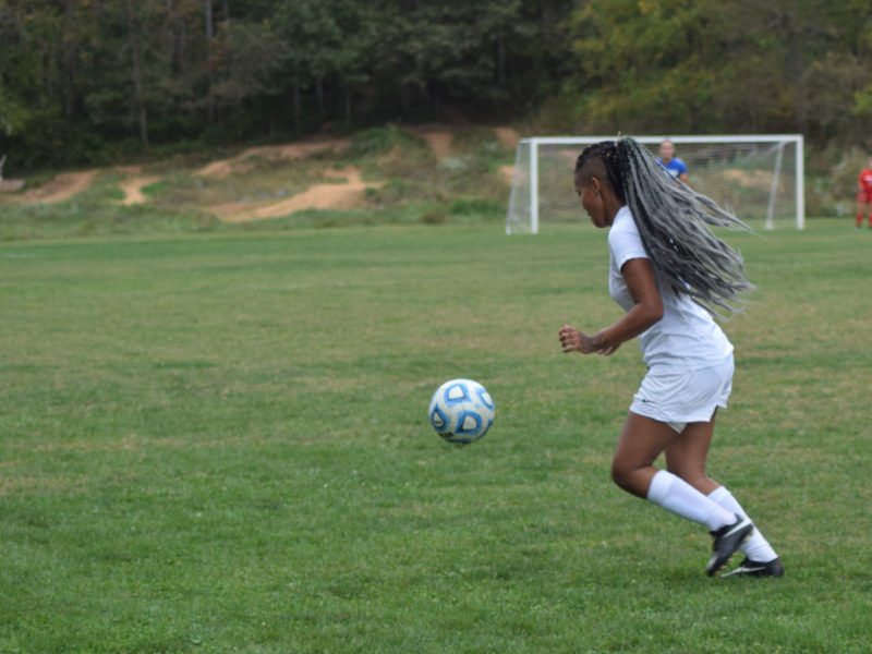 Student playing soccer