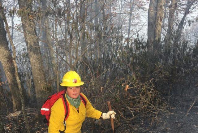 Junior Melina Lozano works on a fire off Bee Tree Road in Swannanoa last November.