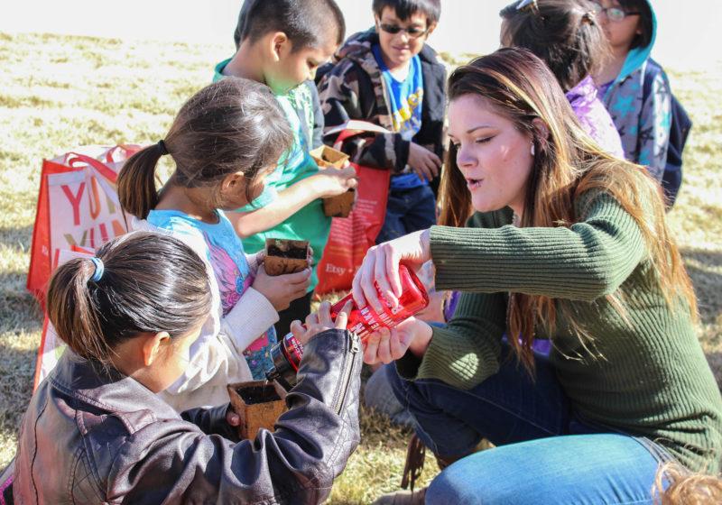 Student works with children at Pine Ridge
