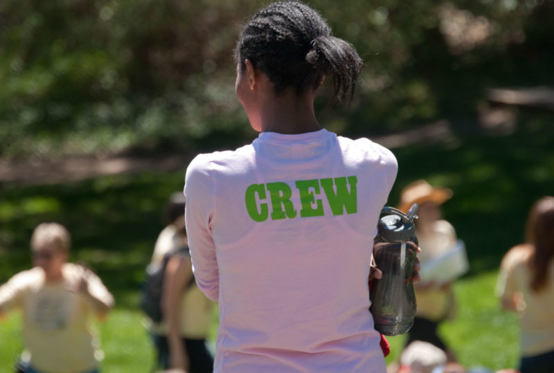 woman with crew on her shirt