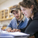 students collaborate on computer