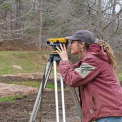 student surveying land
